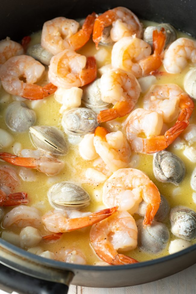 shrimp, scallops, clams in garlic and butter