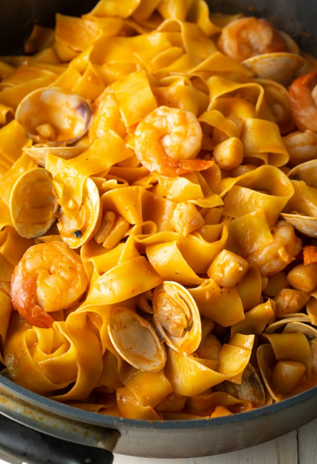 pappardelle noodles with a rich seafood and tomato sauce