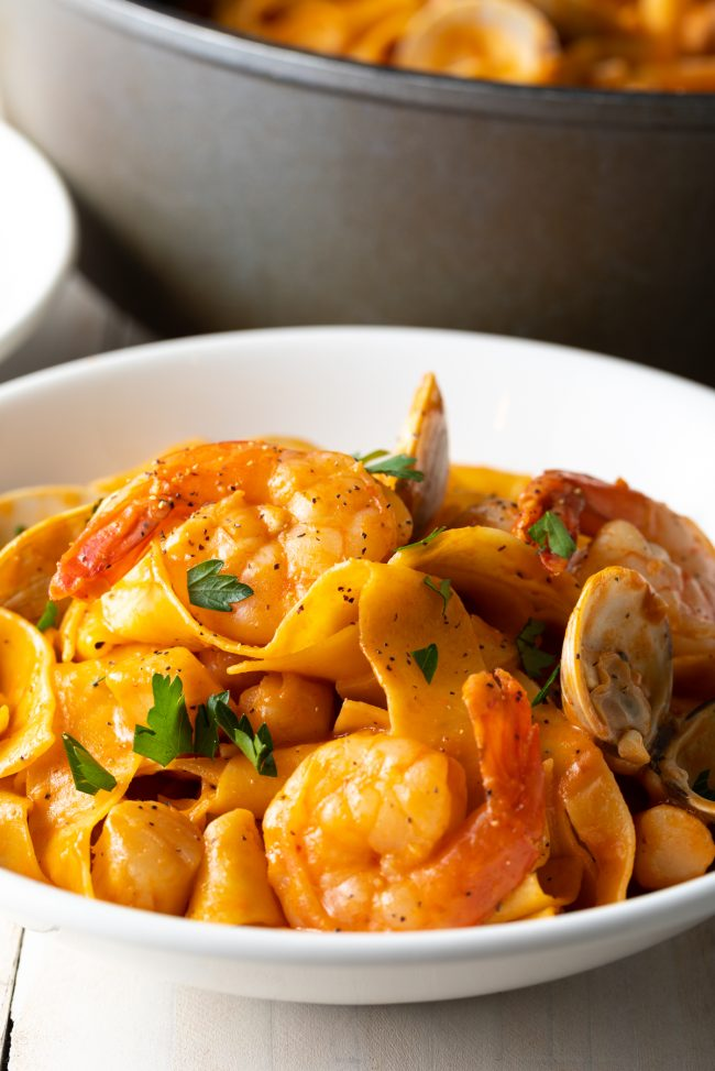 shrimp, clams, scallops sauce with wide pappardelle noodles