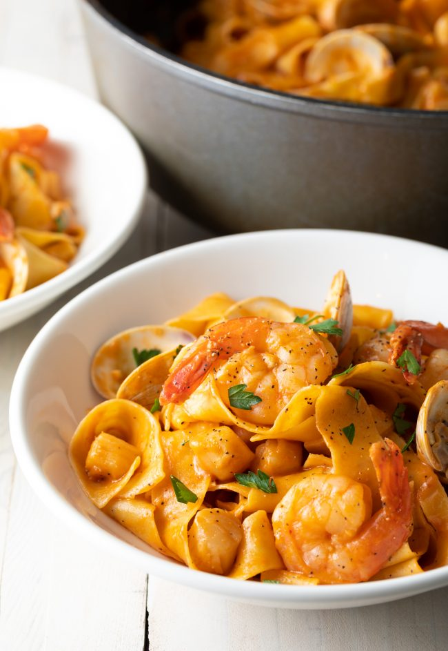 shrimp, scallops, mussels in a tomato sauce with pappardelle pasta