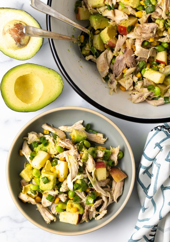 serving of chicken salad with avocado, apples, and corn