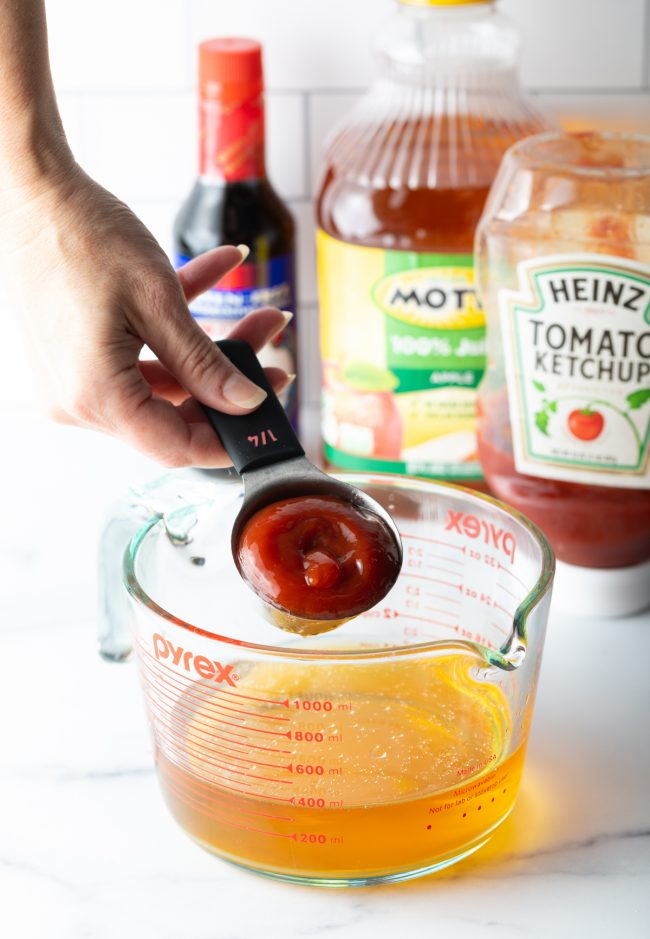 mixing together ingredients to make the sauce