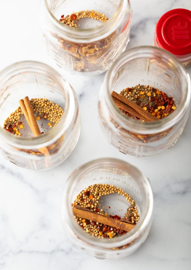 jars with seeds, peppers, cinnamon sticks