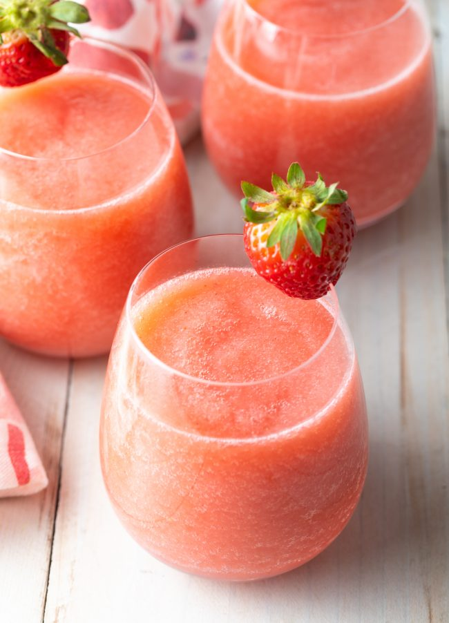 Frosé made with strawberries, vodka, and blush wine - garnished with a strawberry