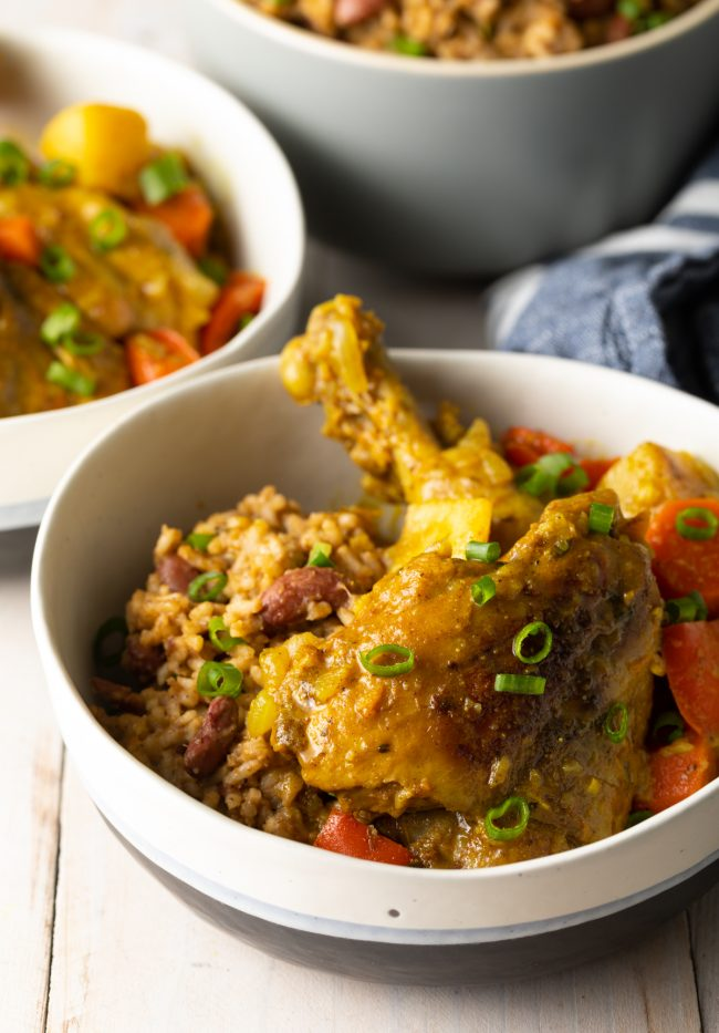 Jamaican curry chicken in a bowl with rice
