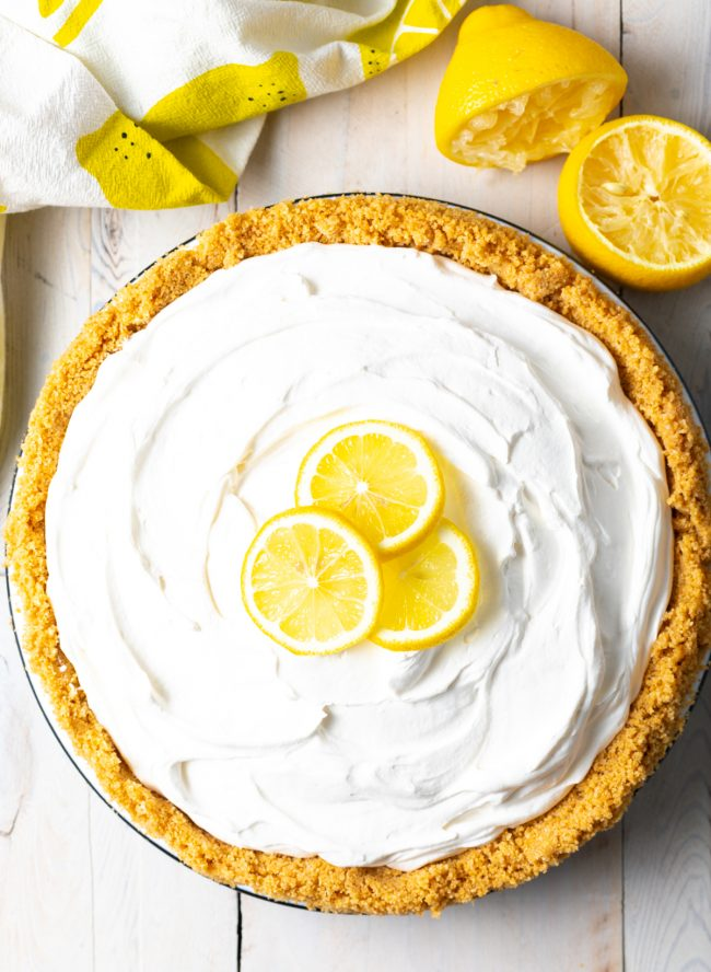 overhead view of a full no bake icebox pie with slices of lemon