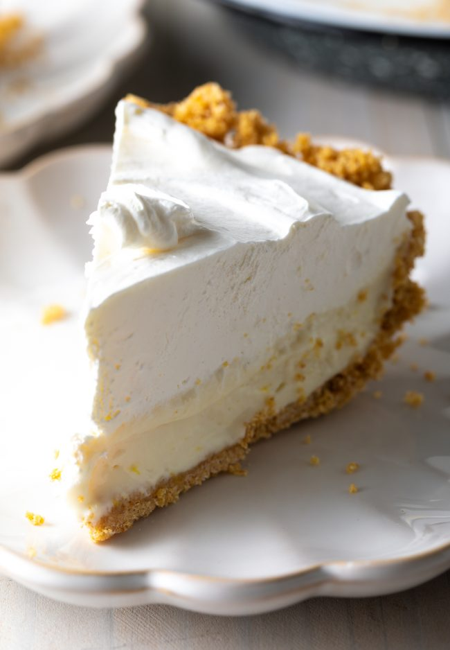 slice of icebox pie with creamy lemon filling and whipped topping