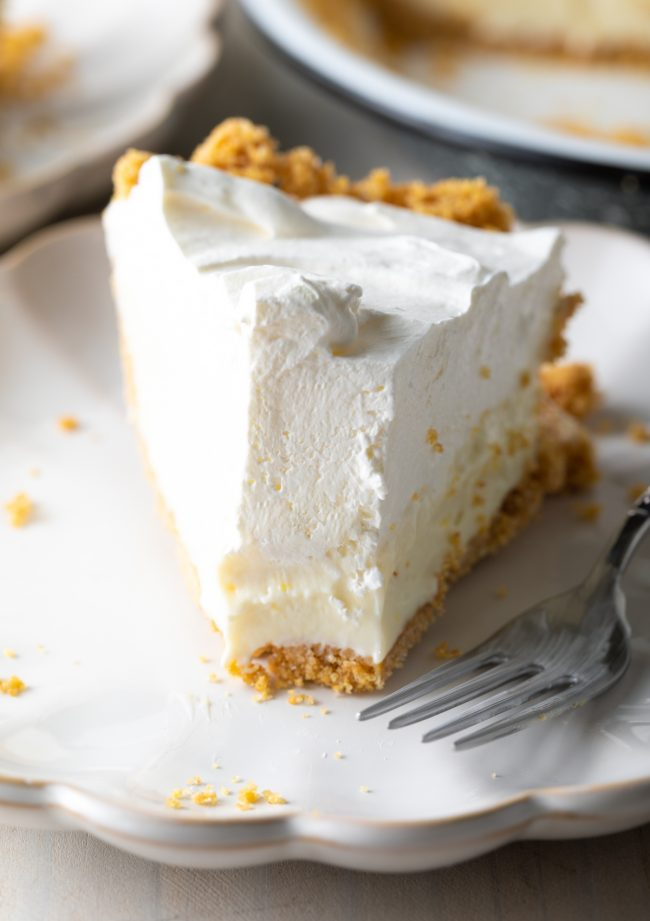piece of pie on a plate with bite taken