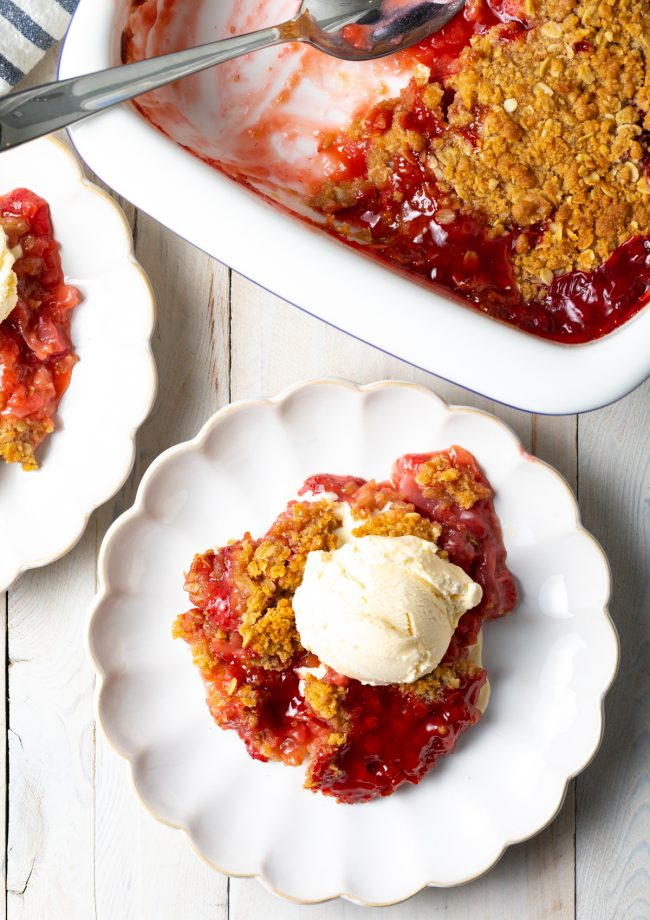 homemade strawberry and rhubarb crumble with ice cream