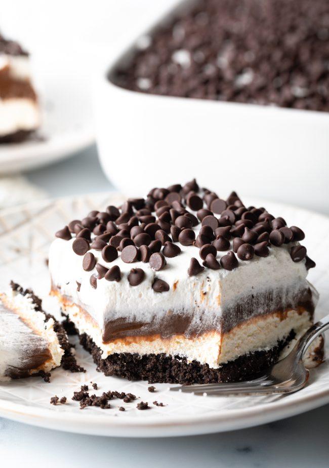 slice of no-bake chocolate lasagna pudding cake with bite taken
