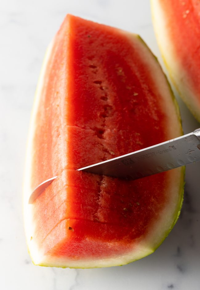 cutting watermelon into slices