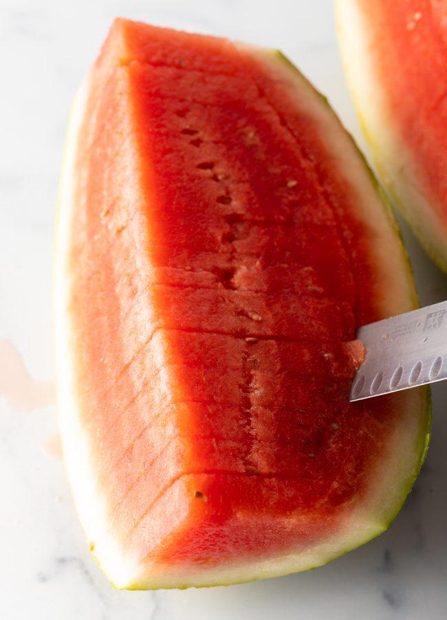 slicing a watermelon