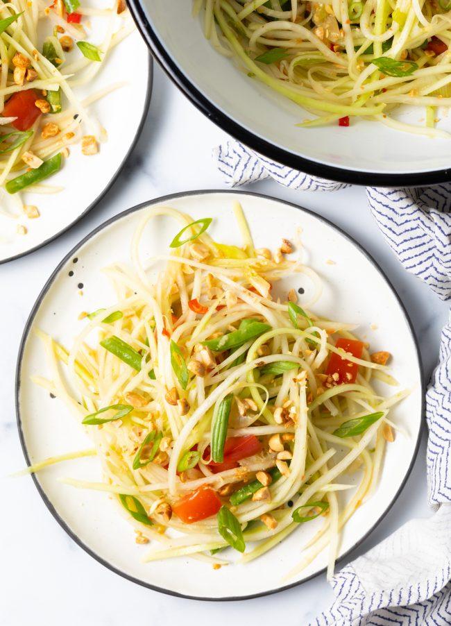 overhead view of green papaya thai salad on plates