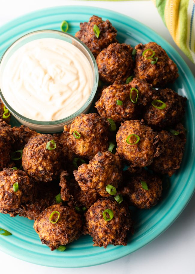 plate of fried seafood balls with remoulade