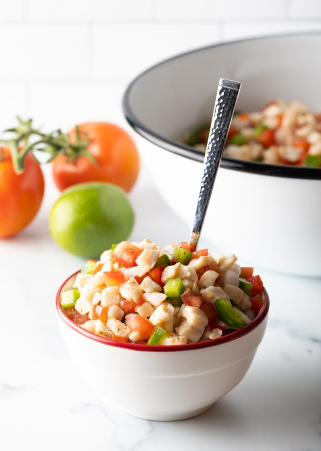 bowl of raw seafood salad with spoon