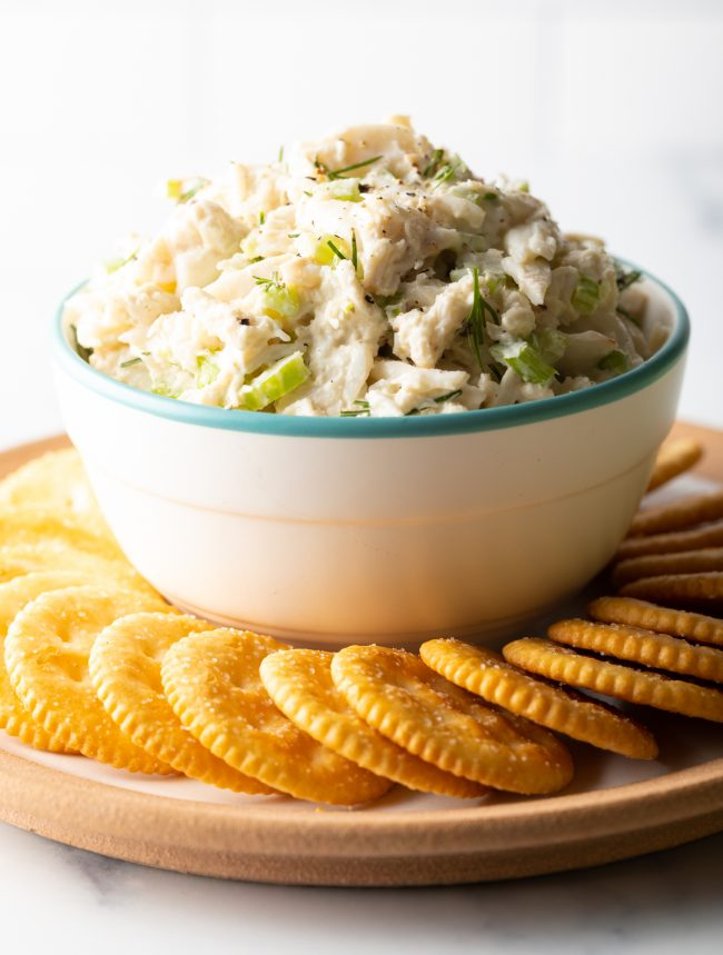 bowl of crab salad with crackers