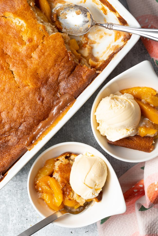 overhead view peach cobbler in dish and bowl