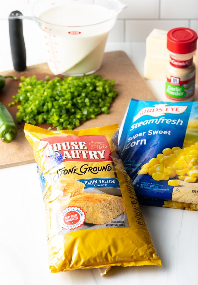 recipe ingredients corn, chopped peppers on a cutting board