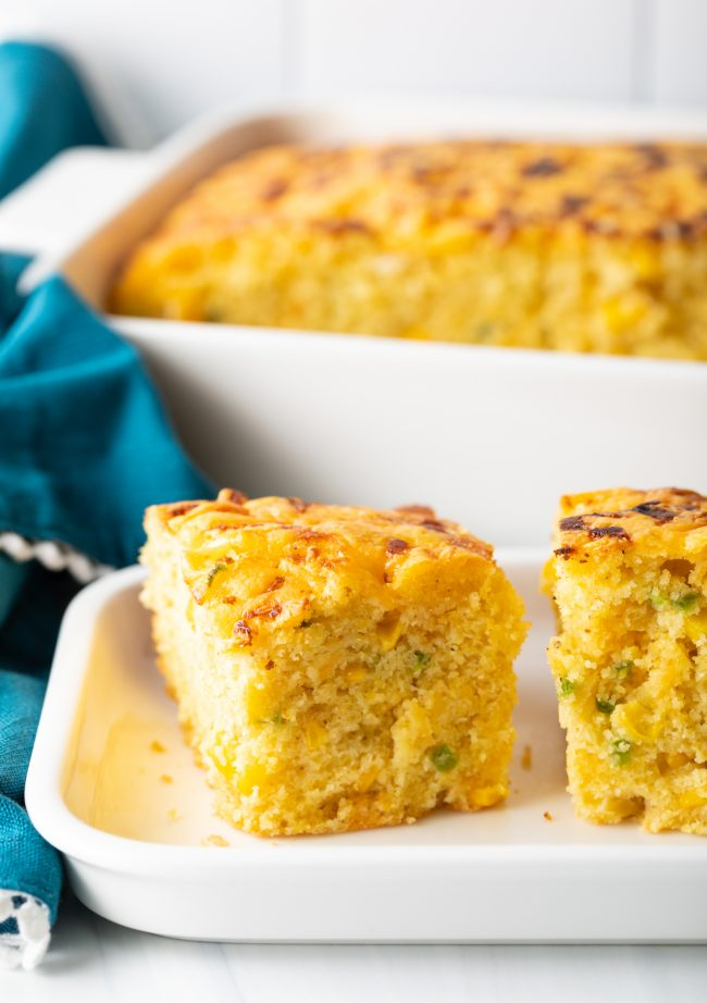 side view of cornbread squares filled with chopped peppers and topped with cheese