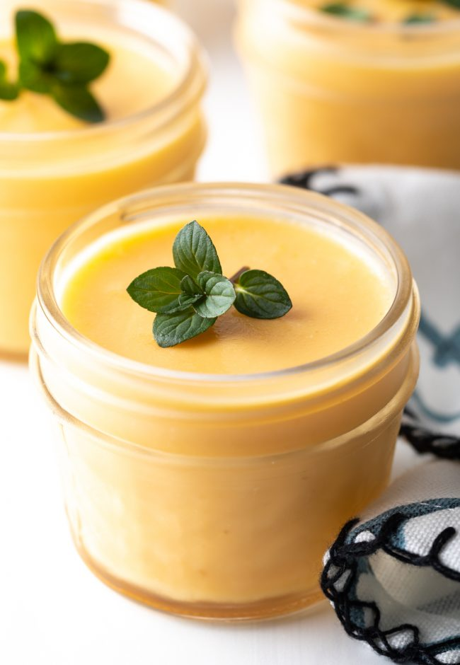 up close view of dairy free mango pudding with fresh mint leaves - Chinese dessert recipe