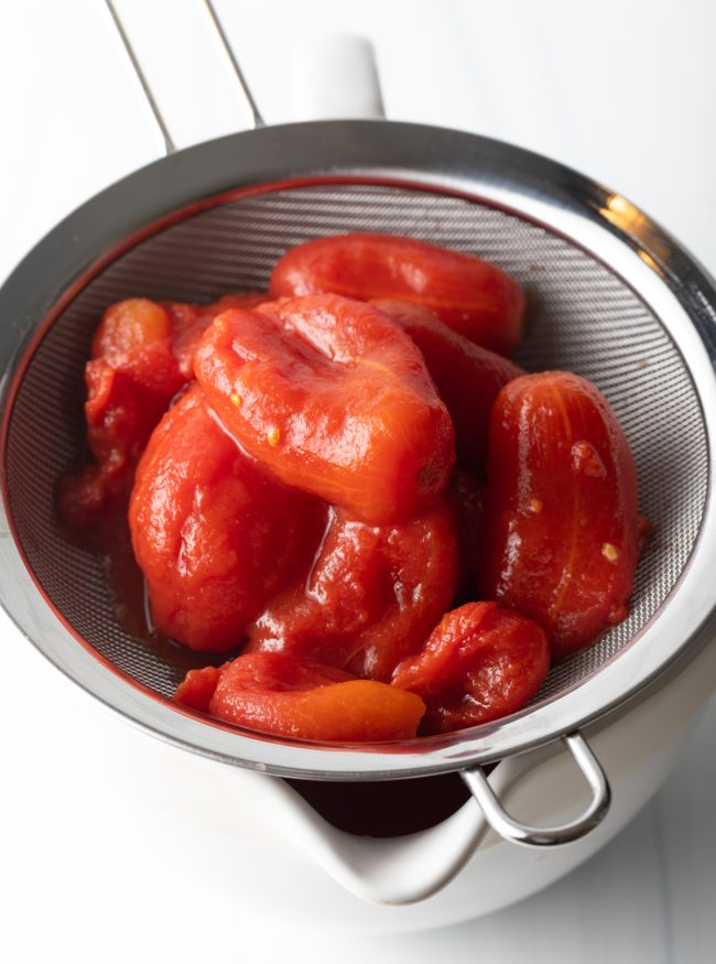 tomatoes in a sieve