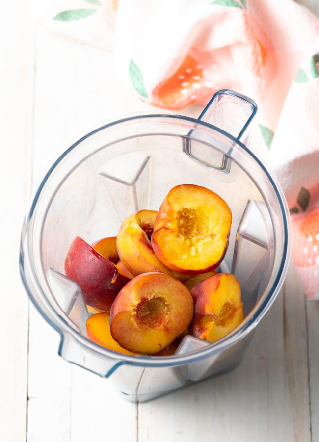halved peaches in a blender