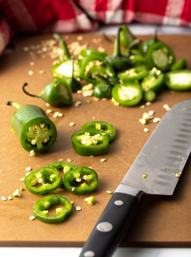 sliced peppers on a cutting board with knife