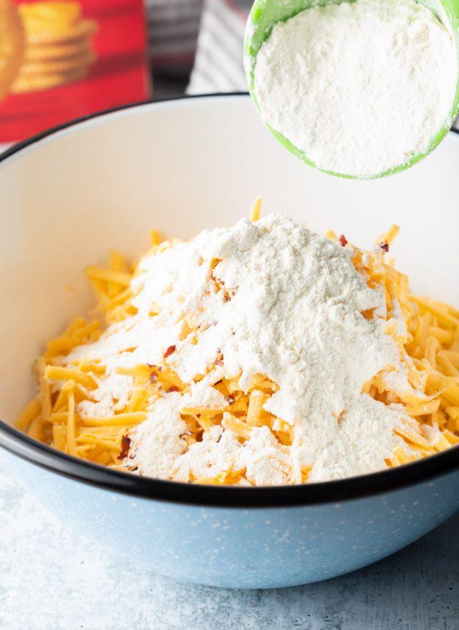 shredded cheddar cheese, flour