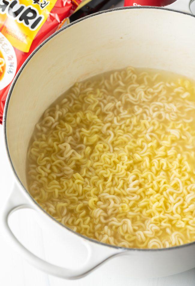 ramen noodles with seasonings in a pot
