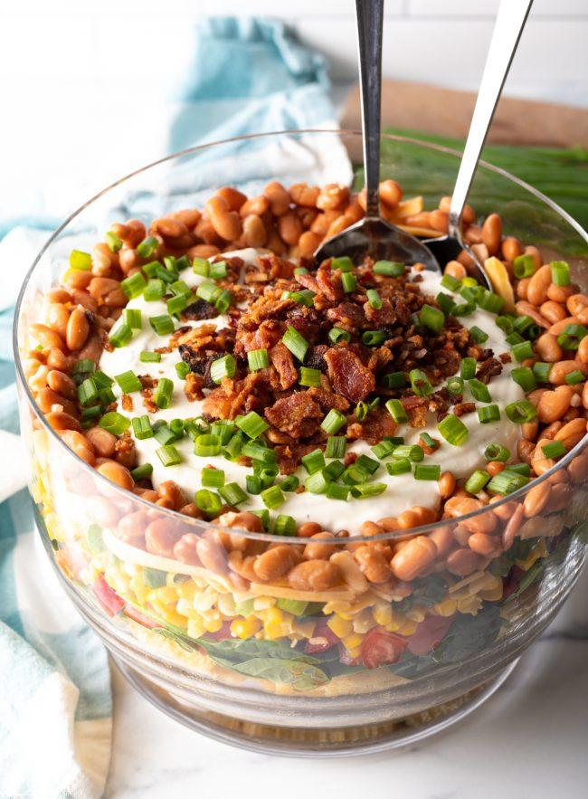 layered cornbread salad in a glass trifle