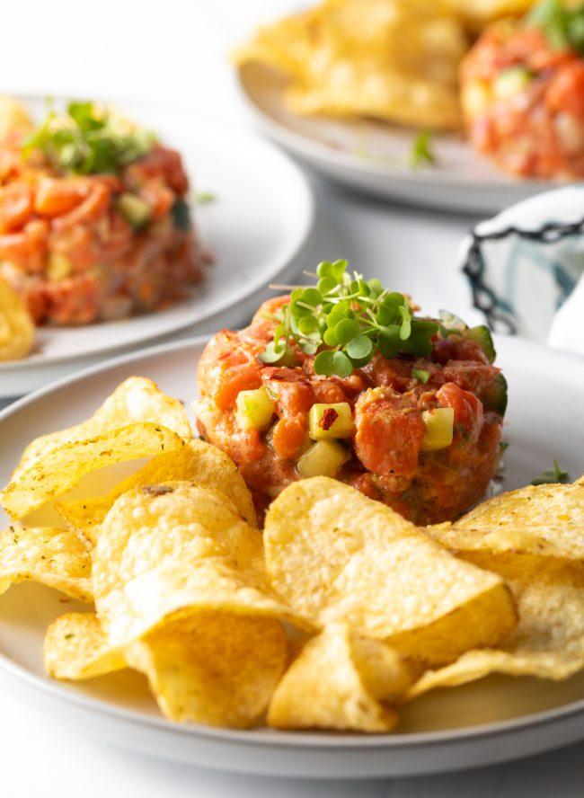 salmon tartare poke recipe with potato chips on a plate