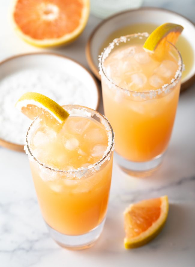 overhead view of two salty dog cocktail drinks with garnishes