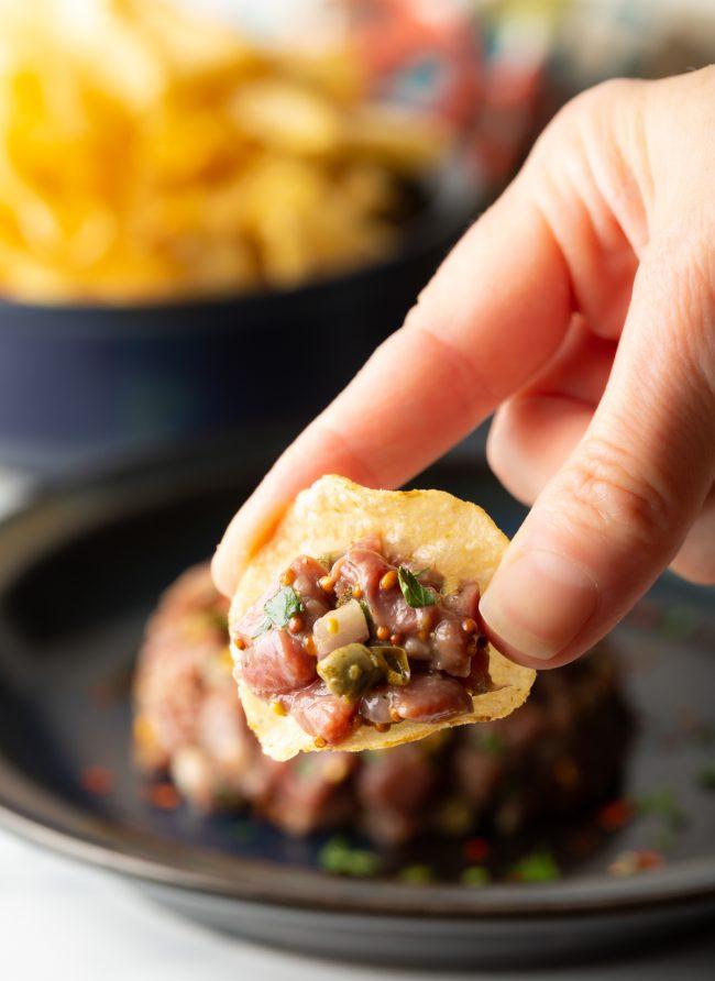 scoop of steak aka beef tartare on a potato chip