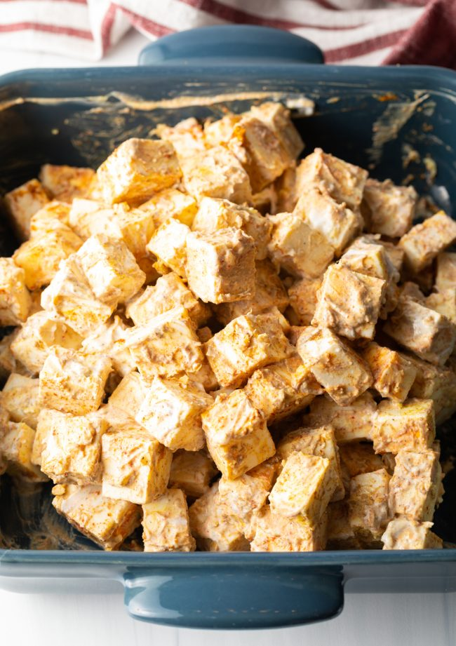 cubes of cheese coated in the yogurt and spices