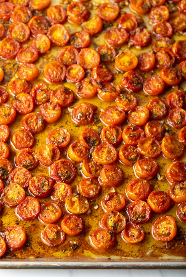 overhead view of baking sheet with balsamic roasted tomatoes