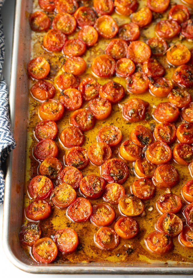 overhead view tomatoes roasting in a pan