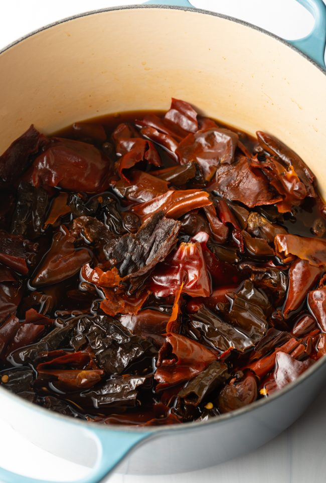 pot with steeped red chiles and raisins