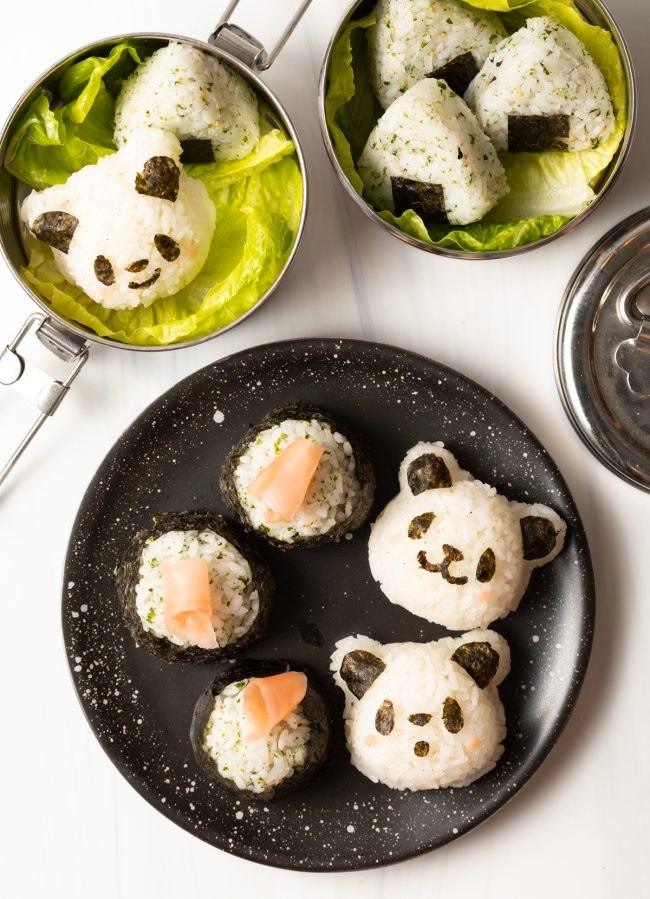overhead top view of Japanese Onigiri in panda face shapes and topped with sushi ginger