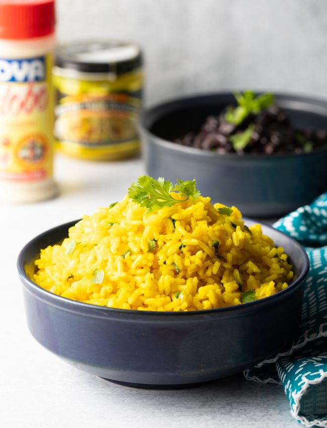 side view of yellow spanish rice in a bowl with cilantro