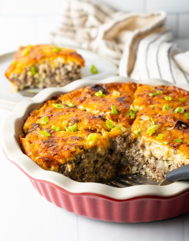 hearty impossible cheeseburger pie with slice removed