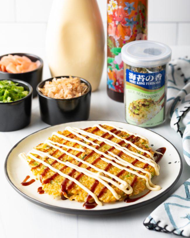adding homemade Okonomiyaki sauce and kewpie mayo
