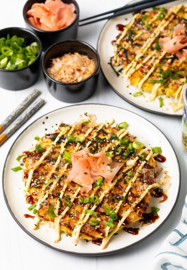 top view of okonomiyaki sauce topped Japanese pancake with sushi add ons