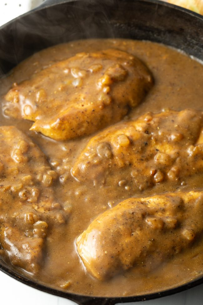 overhead view of boneless skinless chicken smothered in brown gravy