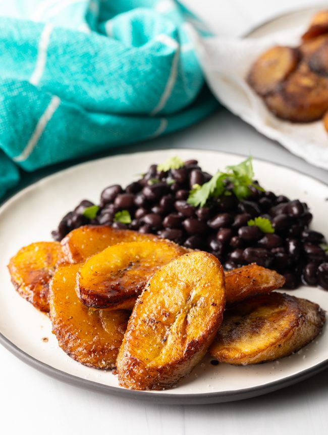 finished plate of fried sweet plantains and black beans