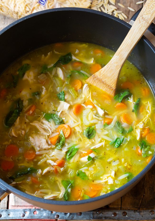 soup in pot with orzo, basil, and chicken